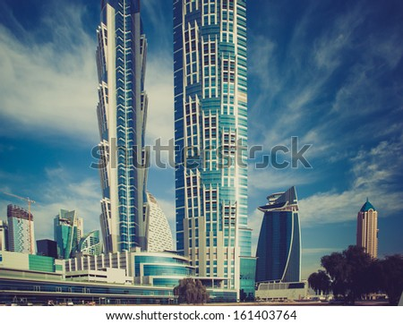 high luxury building skyscraper, blue and white facade with balcony - stock photo