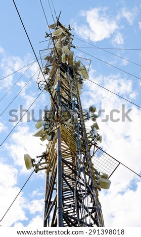 High mast with lots of cellular antennas - stock photo
