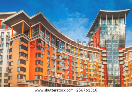 modern apartment design plans. High modern apartment building under blue sky  Modern Apartment Building Stock Images Royalty Free