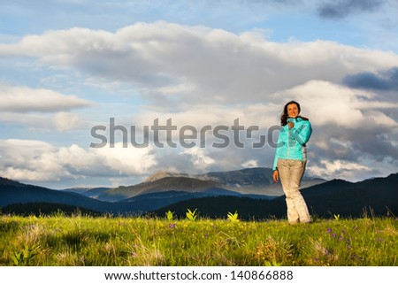 High mountain climber tourist traveling on a sunset