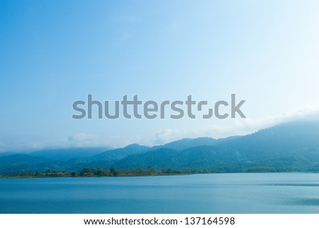 High mountain lake complexes fog covered the summit in the morning. - stock photo