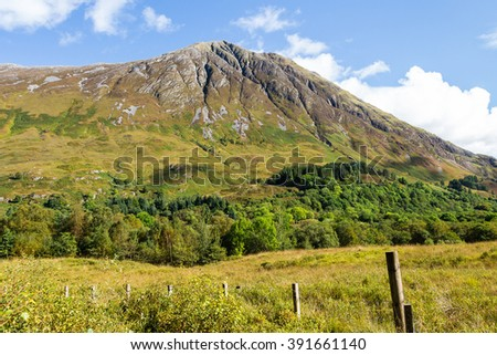 High mountain leading the access to Glencoe valley in a sunny day in Argyle, in the highlands of Scotland. This landscape witnessed the historic massacre between feuding clans Campbell and MacDonald. - stock photo