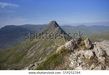 high mountain on sunny day, snowdonia, north wales - stock photo