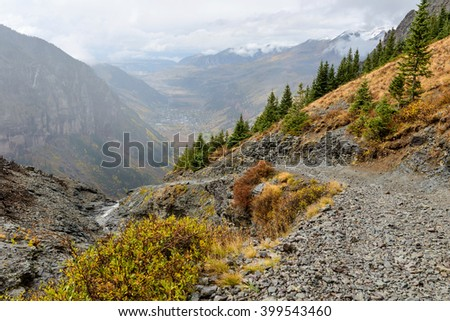 High Mountain Pass - A rainy autumn day on scenic but treacherous Black Bear Pass trail, at side of Ingram Peak, rising 4,000 feet above the town of Telluride, Colorado, USA - stock photo