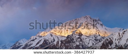 High mountain range during sunrise. Beautiful natural landscape in the summer time.