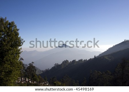 high mountain range on a blue sky and dramatic clouds