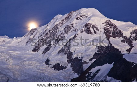High mountain scenery with Liskamm peak and the moon at night