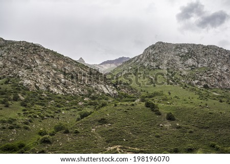 High mountain under heavy clouds - stock photo