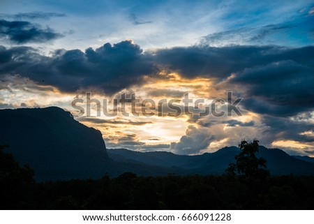 High mountain with clouds in twilight sky
