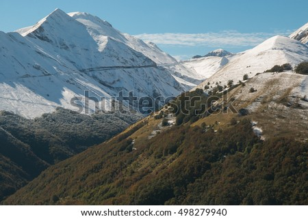 High mountain with snow in the autumn season