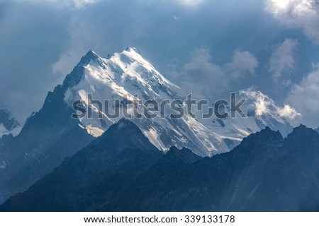 High mountains in clouds - stock photo