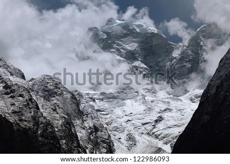 High mountains in white cloud. Nepal. Everest