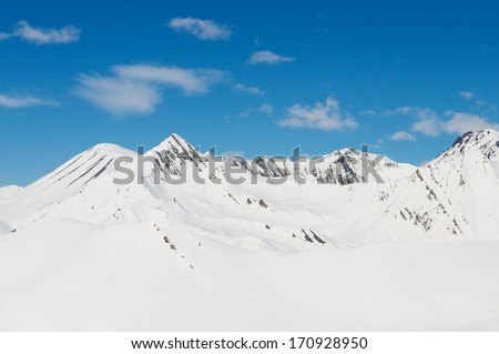 High mountains under snow in the winter - stock photo