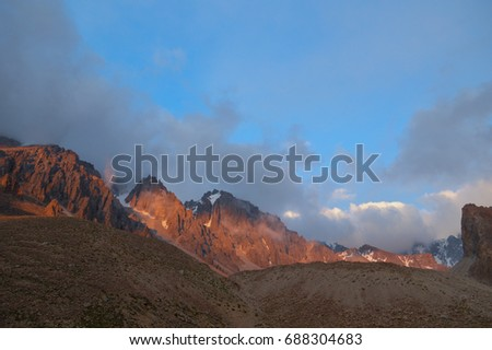 High mountains with snow and ice at sunset