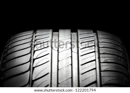 High-performance summer tire for sport cars. Studio shot. - stock photo