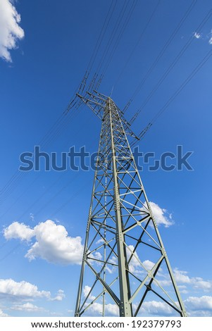 high pipeline pylon power tower on sky with clouds