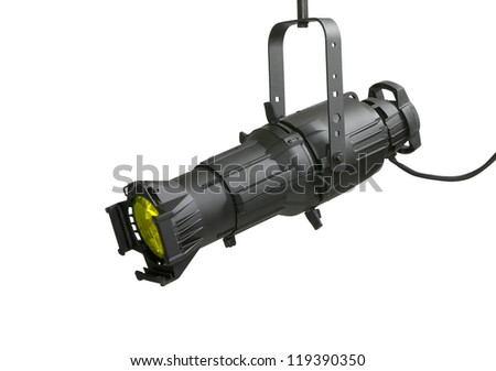 High power ellipsoidal lighting fixture with a yellow filter used in theatrical and stage productions and in the motion picture industry. - stock photo
