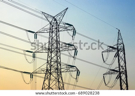 High-power pylon with morning light, with blue sky view