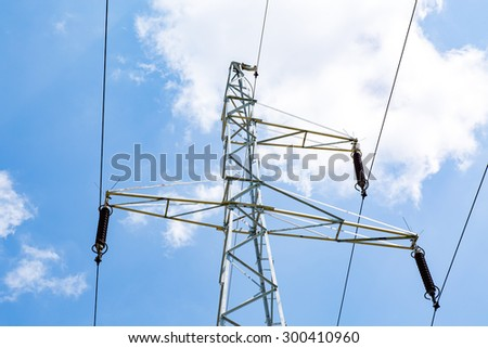 High powerlines on the blue clear sky - stock photo
