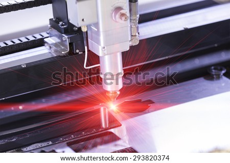 High precision CNC laser cutting metal sheet - stock photo