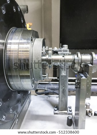 High precision CNC machining center working, operator machining automotive part camshaft process in factory