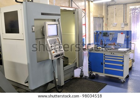 High precision lathe with control panel. - stock photo