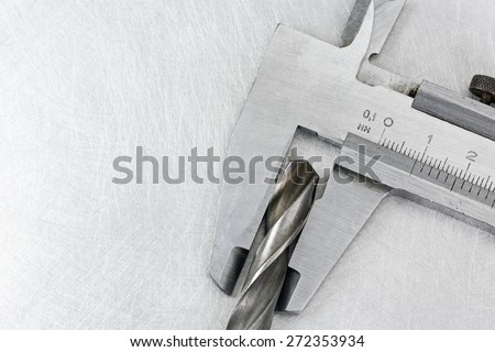 High precision measurement tool on metal background - stock photo