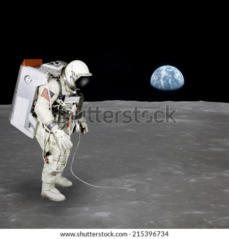 High quality isolated composite astronaut walking on moon. Elements of this image furnished by NASA - stock photo