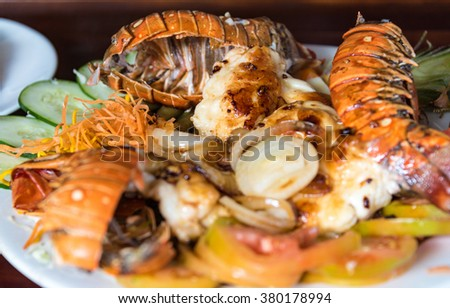 High quality lobster dish sold in the Santa Rosalia restaurant. Lobster and all kinds of seafood are very popular in Cuba restaurants at very affordable prices - stock photo