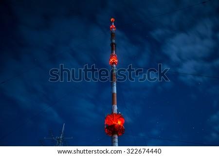 high radio tower at night - stock photo