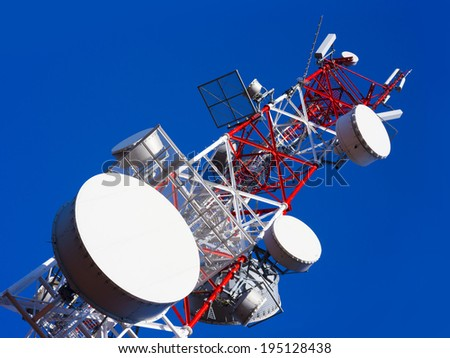 high radio tower with blue sky background - stock photo