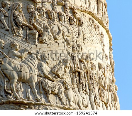 high-reliefs with scenes of war and warriors sculpted in Trajan's column in Rome - stock photo