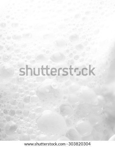 High resolution beautiful splash of fresh milk. White background. Texture. - stock photo