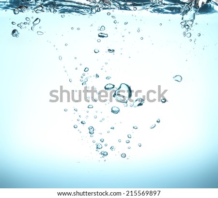 high resolution. bubbles in clean drinking water. beautiful blue background.