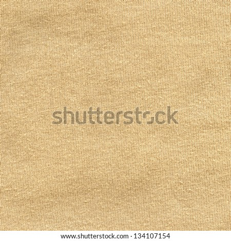 High resolution close up of beige cotton fabric.