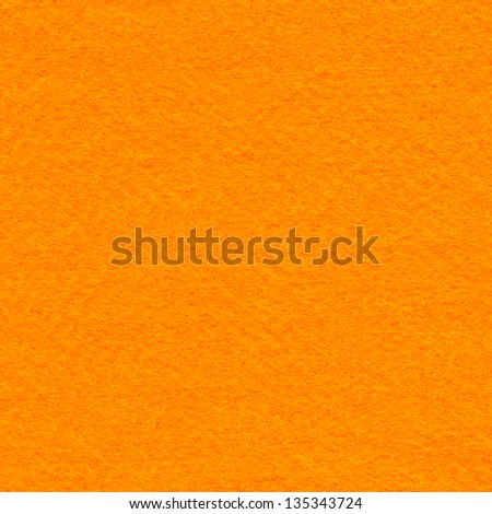 High resolution close up of orange felt fabric. - stock photo