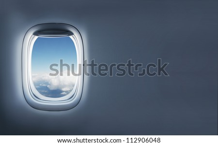 High resolution clouds in aircraft's porthole - stock photo