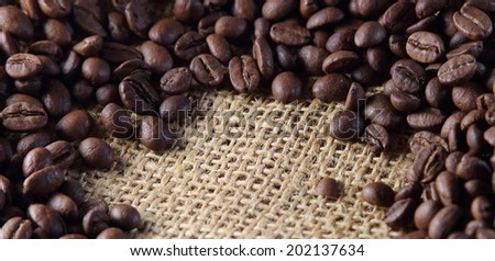 High resolution Coffee beans spilled out onto the old sacking. beautiful background - stock photo