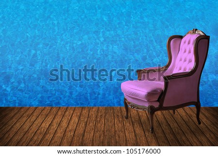 High resolution creative wood floor with vintage armchair and swimming pool background - stock photo