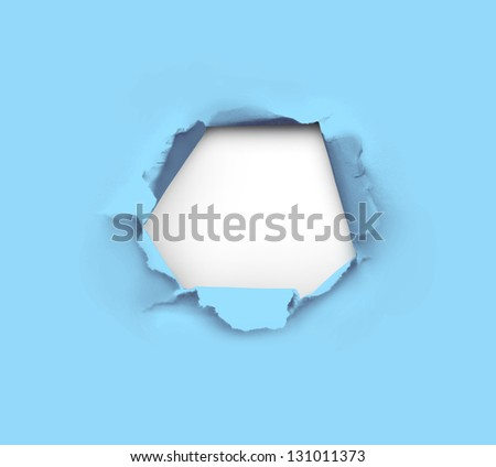 high resolution hole in blue paper