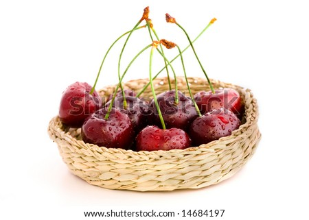 High resolution image of wet fresh cherries in a basket