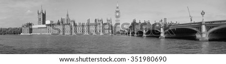 High resolution panoramic view of the Houses of Parliament Big Ben and Westminster Bridge seen from river Thames in London, UK in black and white - stock photo