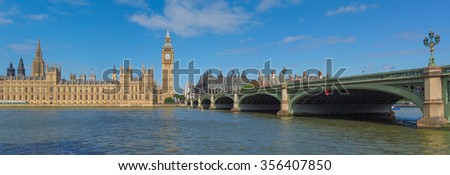 High resolution panoramic view of the Houses of Parliament Big Ben and Westminster Bridge seen from river Thames in London, UK - stock photo