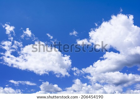 High resolution photo of cumulus clouds against a blur sky. Great background image for composites.  - stock photo