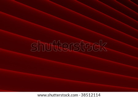 high resolution red satin folded fabric ideal for backgrounds - stock photo