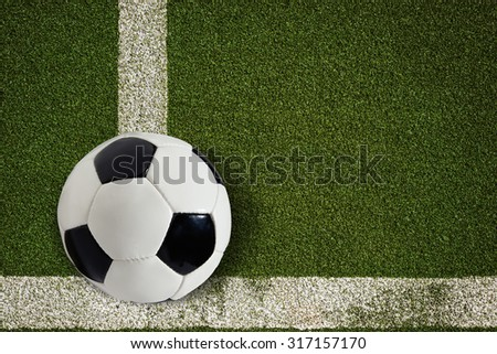 High resolution soccer ball on green field