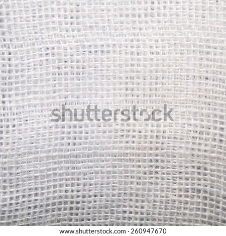 High resolution white and light gray texture of gauze background with sparse threads and clear space for your own text - stock photo