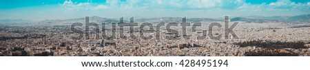 High resolution wide aerial panorama of Athens, Greece showing the topography of the city and its architecture in a travel and tourism concept