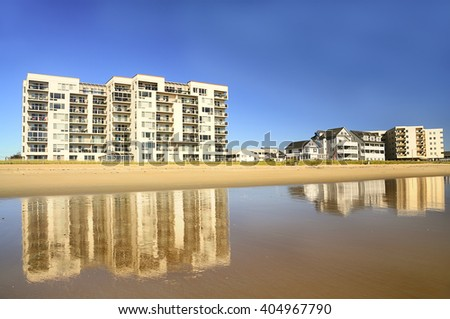 high-rise and small houses on the beach, the ocean. the coastline, sandy beach. The calm quiet water. Maine. Portland.  - stock photo