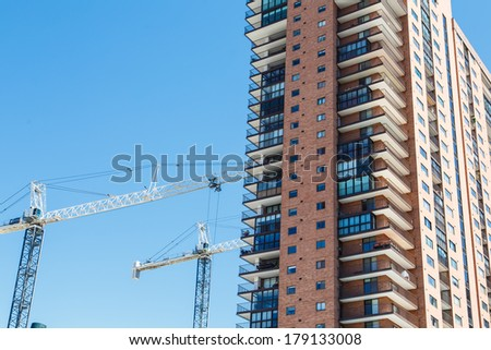 High rise apartment building with many balconies - stock photo